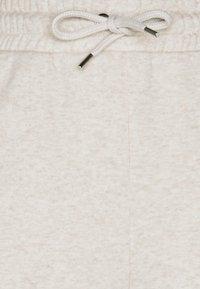 Monki - Teplákové kalhoty - white dusty light - 4