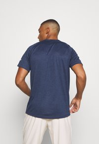 adidas Performance - FREELIFT AEROREADY TRAINING SHORT SLEEVE TEE - Basic T-shirt - mottled dark blue
