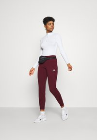 Nike Sportswear - Tracksuit bottoms - dark beetroot/white - 1