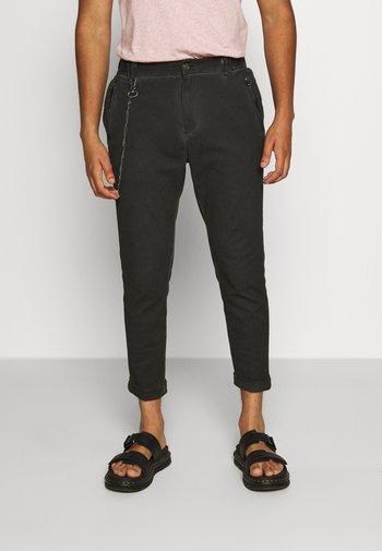 CORNELIO - Trousers - vintage black
