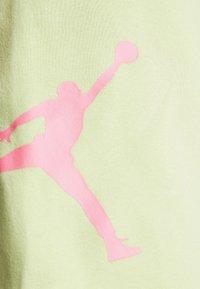 Jordan - JUMPMAN AIR  - Tracksuit bottoms - limelight - 5