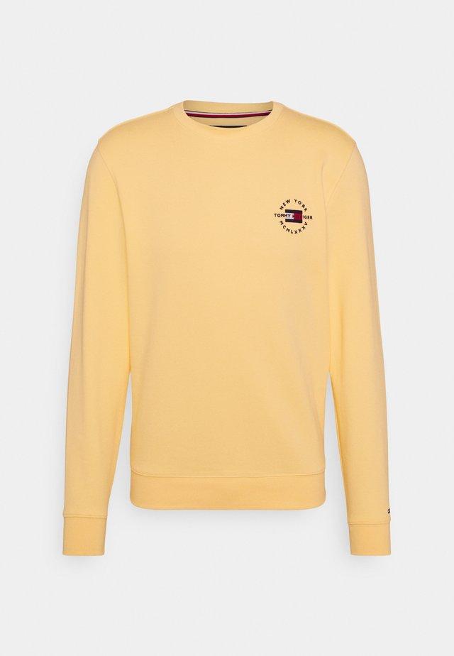 CIRCLE CHEST CORP CREWNECK - Sweatshirt - delicate yellow