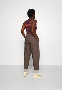 Nike Sportswear - Tracksuit bottoms - ironstone/black - 3