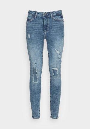 SKINNY MENDING - Jeans Skinny Fit - calypso