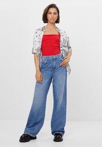 Bershka - Flared jeans - blue - 1