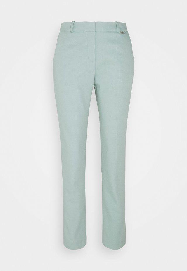 HEDIAS SOFT STRUCTURE - Pantaloni - light/pastel green