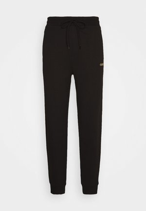 DOAK - Tracksuit bottoms - black / gold