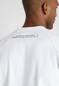 adidas Performance - MUST HAVE ATHLETICS SHORT SLEEVE TEE - Print T-shirt - white/black - 5