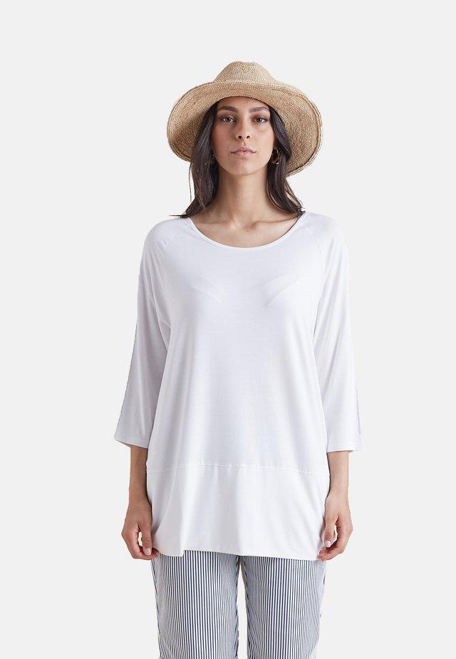 MIT KETTE ENTLANG DER ÄRMEL - Long sleeved top - bianco