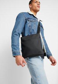 Lacoste - FLAT CROSSOVER BAG - Across body bag - black - 1