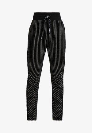 BANANA PANTS TEXT - Tracksuit bottoms - black