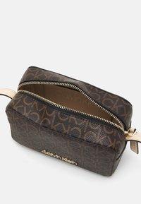 Calvin Klein - CAMERA BAG - Across body bag - brown - 2