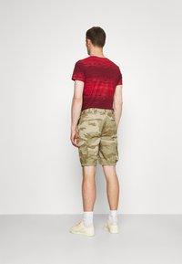 Schott - TROLIMPO - Shorts - beige - 2