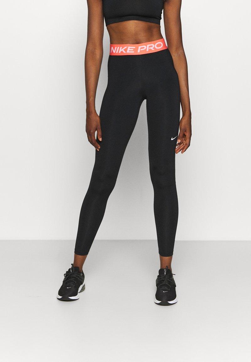 Nike Performance - Legginsy - black/magic ember/white