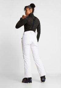 Halti - PUNTTI SKI PANTS - Zimní kalhoty - white - 2
