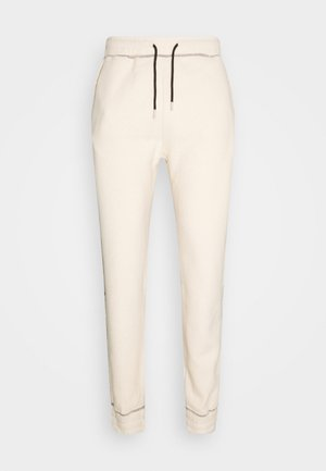 UNISEX CONTRAST STITCH POLAR - Tracksuit bottoms - tan