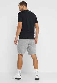 Under Armour - SPORTSTYLE TERRY  - Pantalón corto de deporte - onyx white - 2
