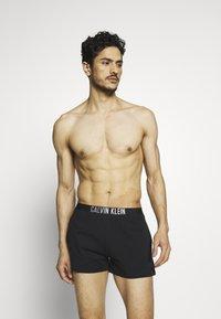 Calvin Klein Swimwear - INTENSE POWER SHORT - Shorts da mare - black - 1