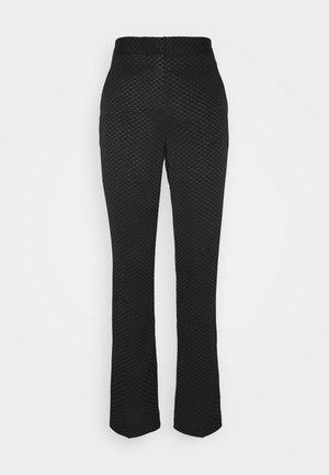 CLINT - Trousers - black