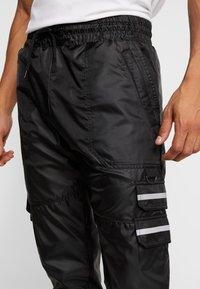 Golden Equation - RIGA  - Cargo trousers - black - 4