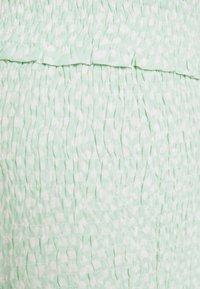 NA-KD - SMOCKED MINI SKIRT - Spódnica mini - green - 2