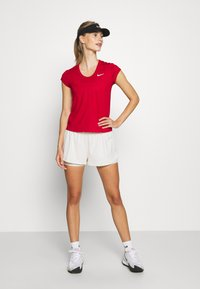 Nike Performance - DRY SHORT - Sports shorts - light orewood/white - 1