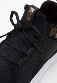 Puma - ENZO EDGE - Neutral running shoes - black/gold - 5