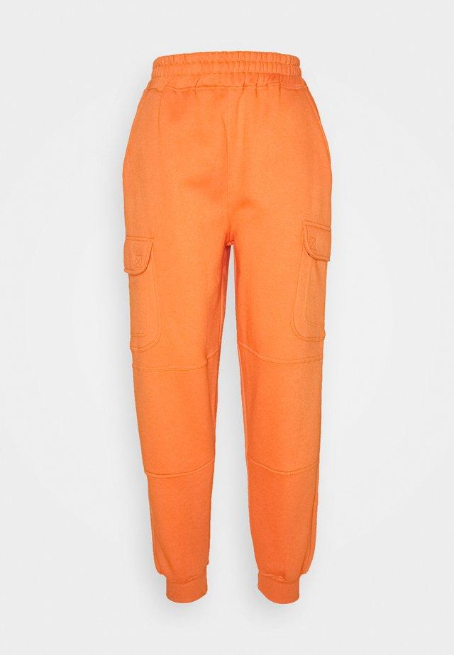 POCKET DETAIL - Tracksuit bottoms - orange