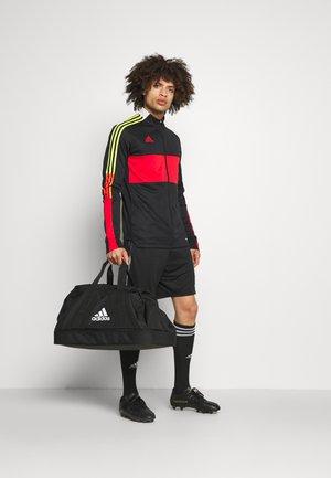 TIRO - Sports bag - black/white