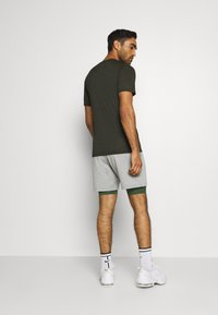 Nike Performance - SHORT LONG - Medias - galactic jade/black - 2
