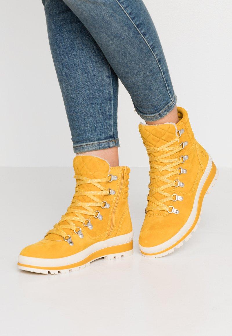 Tamaris - Lace-up ankle boots - saffron