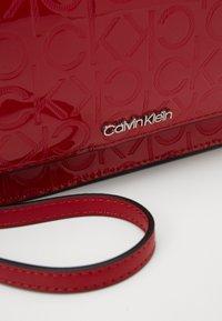 Calvin Klein - MUST CROSSBODY - Wallet - red - 2