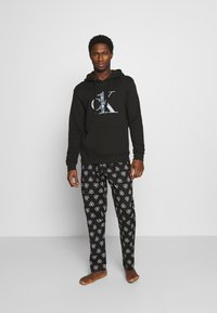 Calvin Klein Underwear - ONE RAW EDGE HOODIE - Maglia del pigiama - black - 1