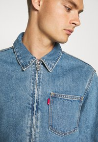 Levi's® - MECHANIC'S TRUCKER - Cowboyjakker - light blue denim