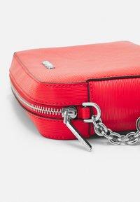 Calvin Klein - CAMERA BAG WAVE SAFFIANO - Across body bag - red - 3