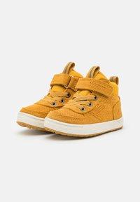 Viking - SAMUEL MID WP UNISEX - Hiking shoes - mustard - 1