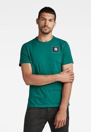 T-shirt con stampa - bright laub