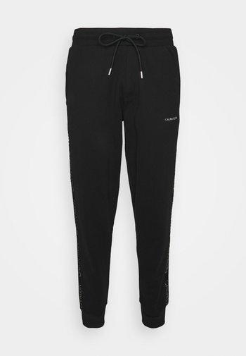 LOGO - Pantaloni sportivi - black/silver-coloured