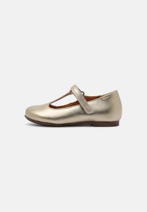 FIONAS T-BAR - Ankle strap ballet pumps - gold