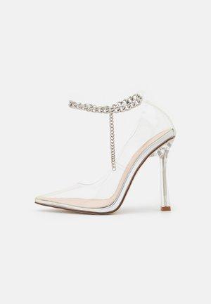 RIDHAM - Classic heels - clear