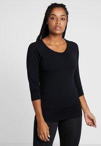 Curare Yogawear - Long sleeved top - black - 0