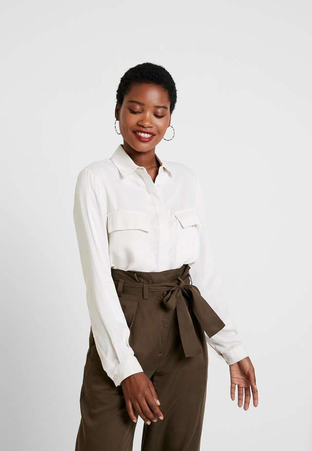 BLOUSE WITH POCKETS - Button-down blouse - ivory