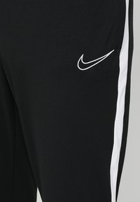 Nike Performance - DRY ACADEMY - Tracksuit bottoms - black/white - 6