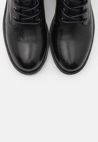 Carmela - LADIES BOOTS  - Lace-up ankle boots - black - 5
