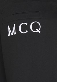 McQ Alexander McQueen - ANEIGMA - Tracksuit bottoms - black - 2