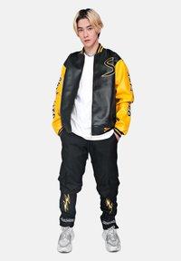 SEXFORSAINTS - ANTI-HERO VARSITY - Faux leather jacket - metallic black - 1