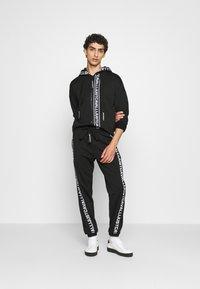 Just Cavalli - FELPA CON ZIP - Zip-up hoodie - black - 1