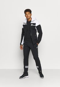 adidas Performance - ESSENTIALS TRAINING SPORTS PANTS - Spodnie treningowe - black/white - 1
