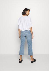 Pieces Petite - PCANE KICK - Flared jeans - light blue denim - 2