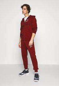 Nike Sportswear - HOODIE - Mikina na zip - team red - 1